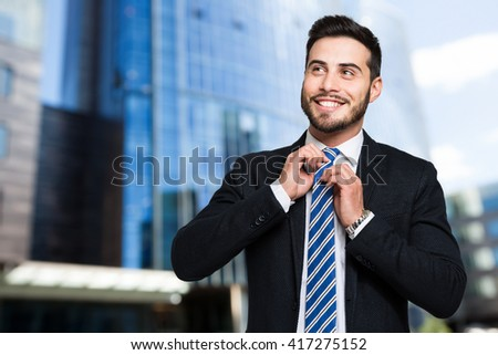 Businessman adjusting his collar outdoor