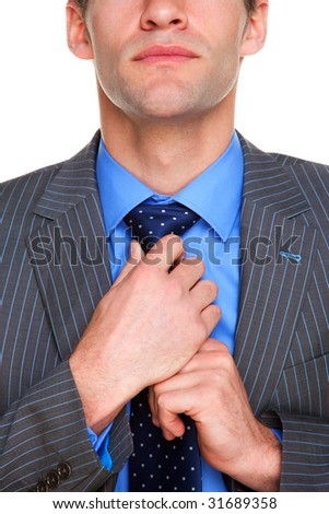 Businessman adjusting his tie getting ready for business, white background. - stock photo