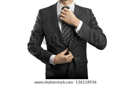 businessman adjusts his tie on white background - stock photo
