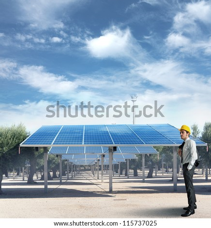 Businessman against an installation of solar panel