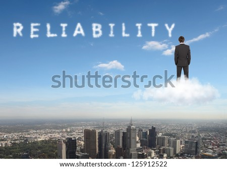 Businessman against blue sky with word reliability writen - stock photo