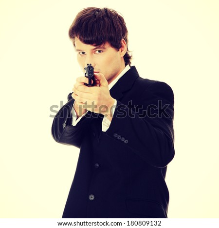 Businessman aiming with handgun - stock photo