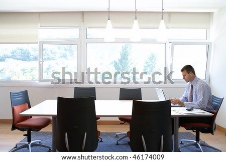businessman alone working in office - stock photo