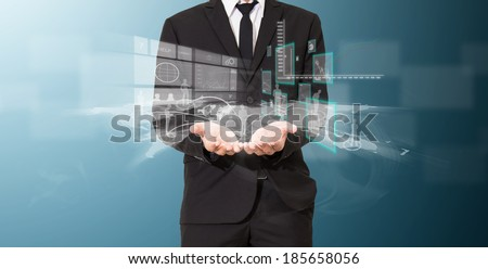businessman analyze graph with technology on hand and connection of business - stock photo