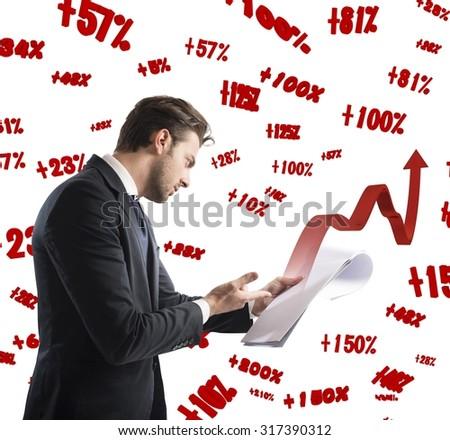 Businessman analyzes work documents of financial profit - stock photo