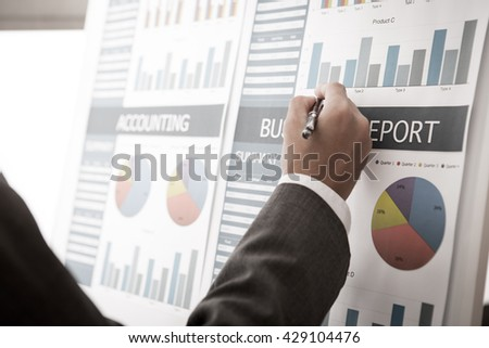 Businessman analyzing investment charts. Accounting - stock photo