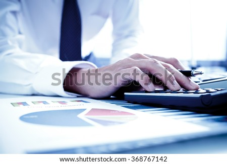Businessman analyzing investment charts with laptop. Accounting - stock photo