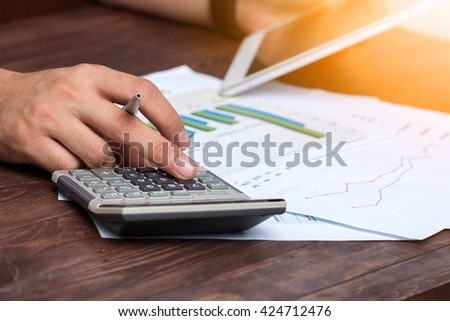 Businessman analyzing sales data. Concept of Business and finance.