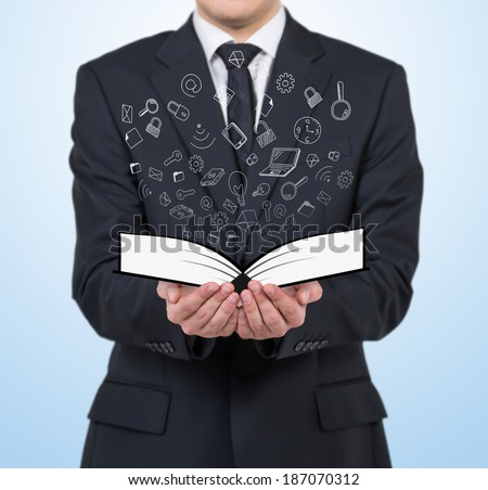 Businessman and a book - stock photo