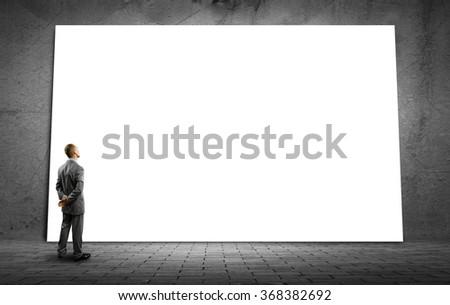 Businessman and big billboard - stock photo