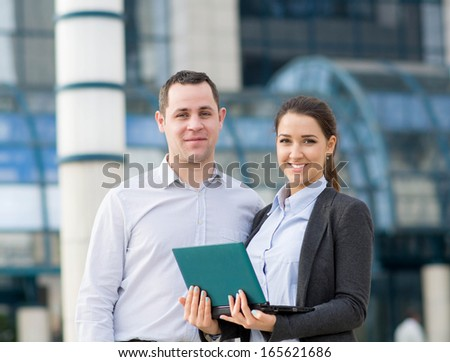 Businessman and bsuinesswoman working outdoor