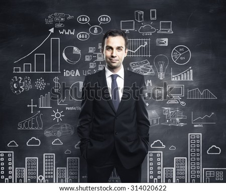 businessman and business plan concept on wall - stock photo