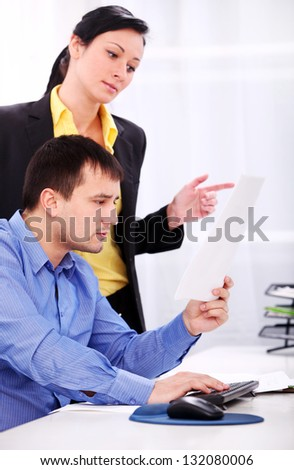Businessman and businesswoman are working at office - stock photo