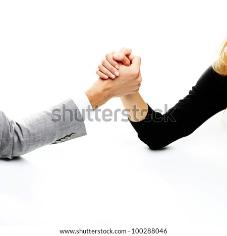 businessman and businesswoman arm wrestling on table.