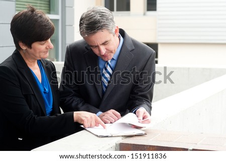 businessman and businesswoman at work outside - stock photo