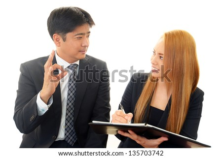 Businessman and businesswoman discussing plans