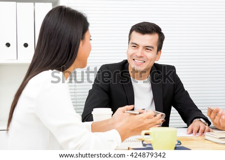 Businessman and  businesswoman  discussing work in the meeting