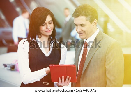 Businessman and businesswoman in modern office,