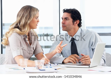Businessman And Businesswoman Meeting In Office - stock photo