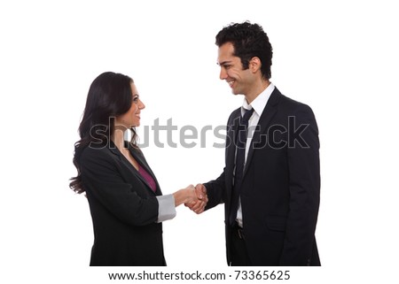 Businessman and businesswoman shaking hands in the studio - stock photo