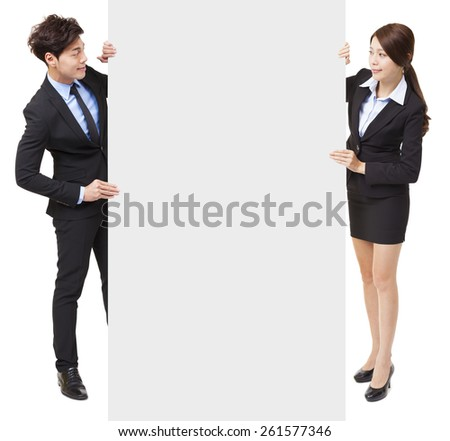 businessman and businesswoman showing the empty board - stock photo