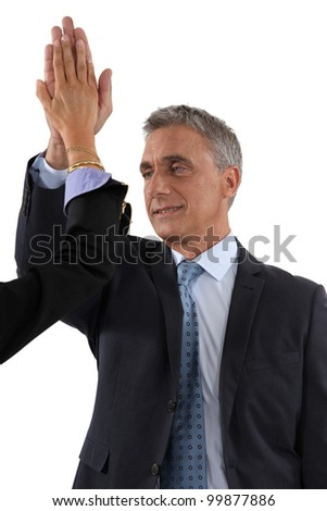 businessman and businesswoman touching hands - stock photo