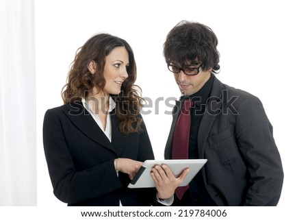 Businessman and businesswoman using a tablet computer, on white background - stock photo
