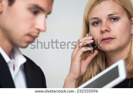 Businessman and businesswoman with digital tablet and smartphone. - stock photo