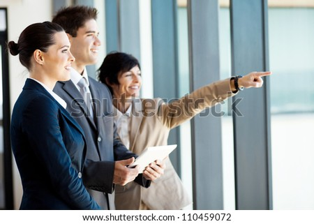 businessman and businesswoman with tablet computer in office - stock photo