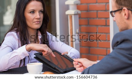 Businessman and businesswomen having a meeting in cafe. - stock photo