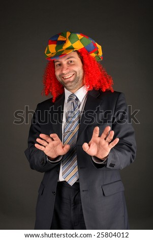 businessman and clown's hat - stock photo