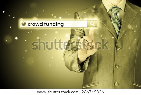 Businessman and crowd funding in search bar - stock photo