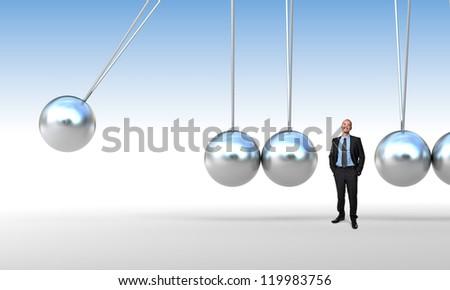 businessman and 3d newton cradle - stock photo