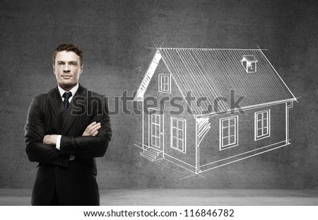 businessman and drawing house on wall
