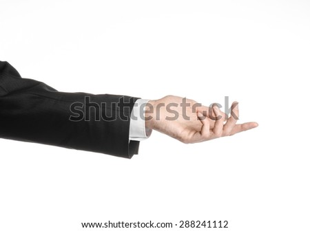 Businessman and gesture topic: a man in a black suit and white shirt showing hand gesture on an isolated white background in studio - stock photo