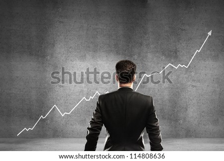 businessman and growth chart in wall - stock photo