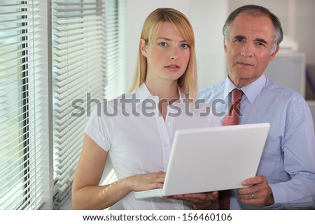 Businessman and his assistant - stock photo