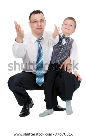 businessman and his son pulled his hands in the studio, isolate on white - stock photo