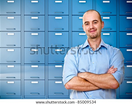 businessman and  image of blue file cabinet - stock photo