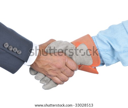Businessman and laborer wearing a work glove handshake isolated over white. Management and Labor negotiation concept. Hands and sleeves only in horizontal format. - stock photo