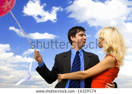 Businessman and lady in red - stock photo