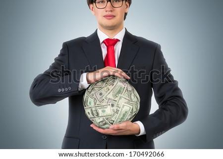 Businessman and money ball 2 - stock photo