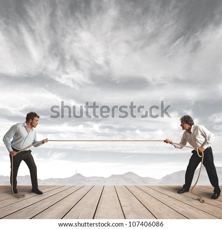 Businessman and pull the rope, Challenge concept - stock photo