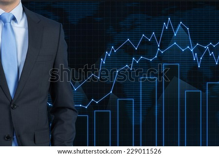 Businessman and rising stock market  - stock photo