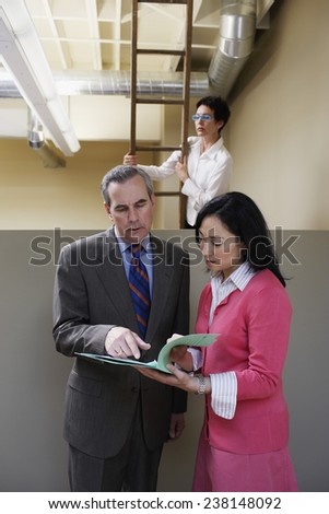 Businessman and Woman Discussing on Document - stock photo