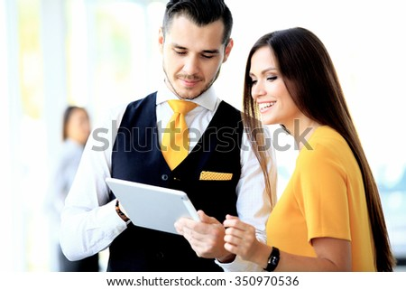 Businessman and woman discussing work - stock photo