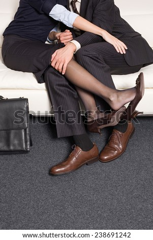 businessman and woman enjoying on the sofa - stock photo