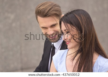 Businessman and woman flirting outdoors