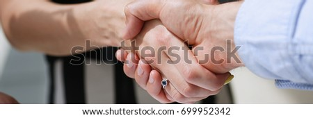 Businessman and woman shake hands as hello in office portrait. Friend welcome, introduction, greet or thanks gesture, product advertisement, partnership approval, arm, strike bargain on deal concept