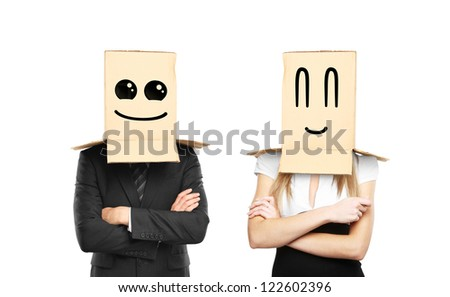 businessman and woman with smiling box on head